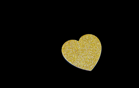 Heart of gold Black background Stock Photo