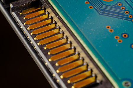 Electronic chip on circuit board Macro close-up shallow DOF