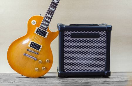 light brown: Electric guitar and amplifier isolated on a  light brown Stock Photo