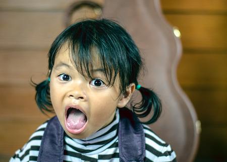 uptight: Little girl asia  on the floor