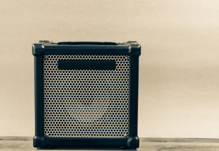 amp: Guitar amplifier isolated  on a  light brown