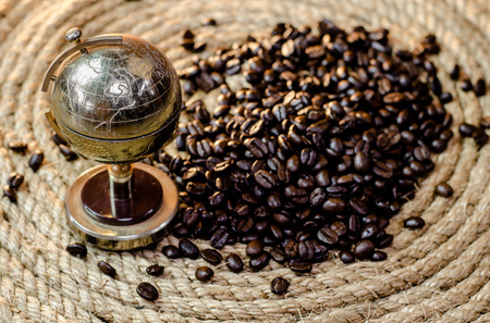 Golden Globes with coffee beans on a jute rope