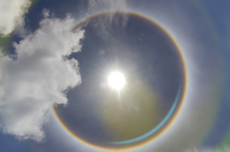 Sun with circular rainbow  sun halo occurring due to ice crystals in atmosphere in thai Фото со стока