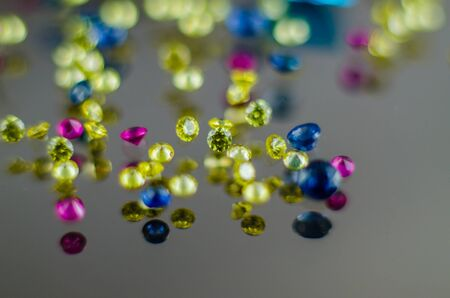 Multi coloured crystals  on white with shallow depth of field