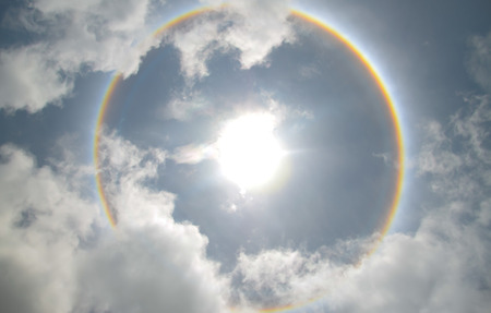 Sun with circular rainbow  sun halo occurring due to ice crystals in atmosphere in thai Stock Photo