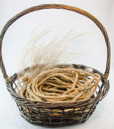 interleaved: Hemp rope wicker brown basket isolated on white
