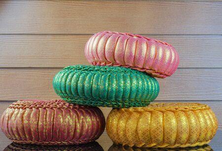 Thai silk Pumkin Pillow on  wood background