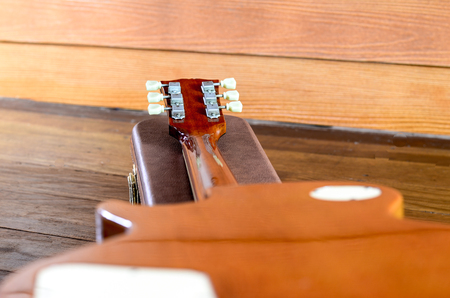 Electric Guitar and case in wood room Stock Photo