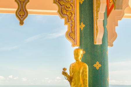 Statue of Buddha standing in Thai temple