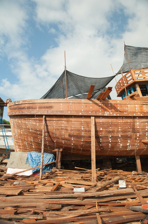 Shipyards and ship building and repairing wooden boats painted  photo