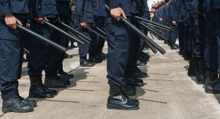 forthcoming: police Training in the use of batons to control crowds. Stock Photo