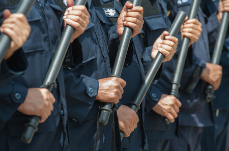 police Training in the use of batons to control crowds. Stock Photo