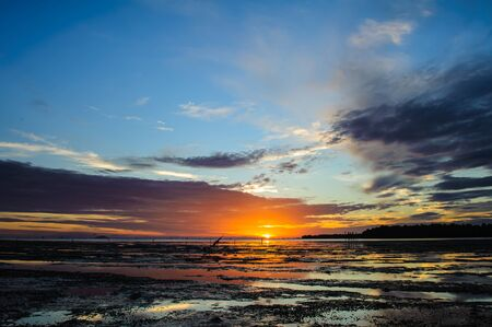 sunrises in the morning sky, clouds and beautiful sea Stock Photo