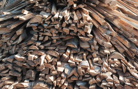 untidily: Wood chips are piled slab.
