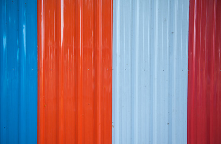 Zinc sheets adept use of temporary barrier walls.