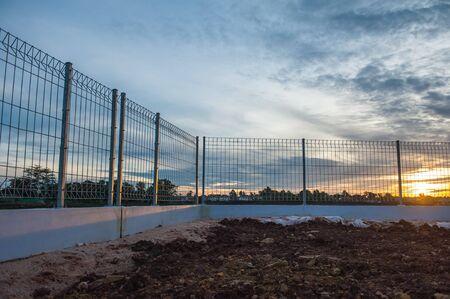 eliminate: Sunrise at the lakeside fence and eliminate freedom. Stock Photo