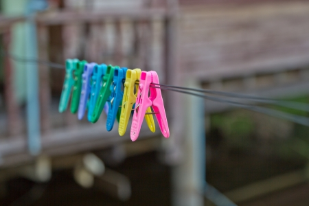 Colorful clothes pin on a clothesline photo