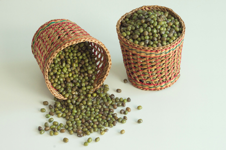 Mung beans in basket on white background