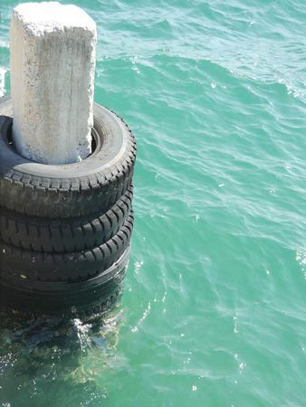 sea water: Pole in The sea water Stock Photo
