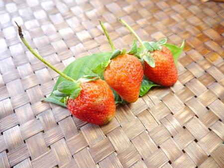strawberrys: Three Strawberrys On Bamboo Mat