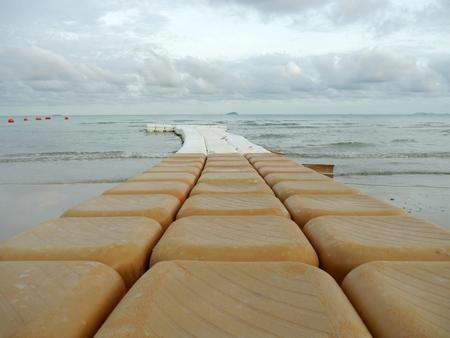 extending: Buoys extending a long way into the sea.