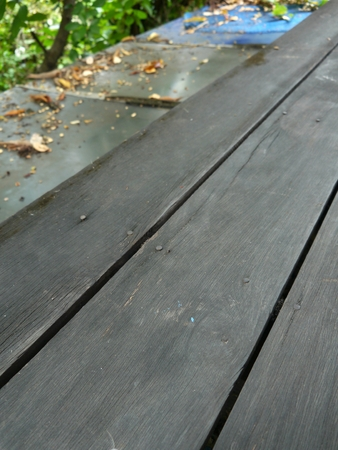 sylvan: Old wooden balcony rails without trees.