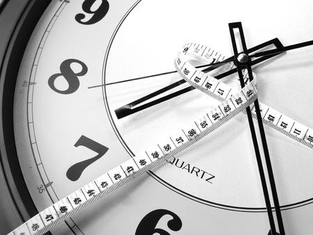 monotone: the big clock and measuring tape monotone Stock Photo