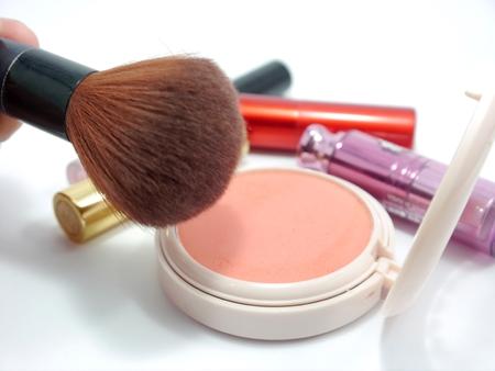 limp: Cosmetic, brush on, lip gross and brush Stock Photo