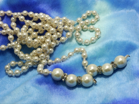 Pearl Necklace On Blue Flannel