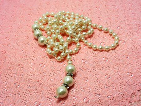 bolus: Pearl Necklace on orange lace