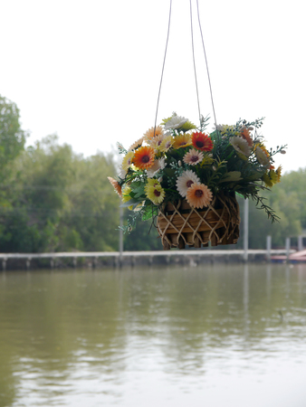 Fake flower basket for decoration Stock Photo
