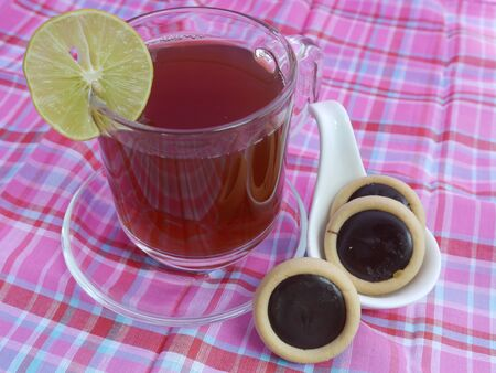 good color: Hot Tea and Chocolate Cookies on dining table