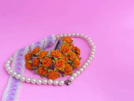 bolus: Pearl Bracelet, Lace and Orange Roses