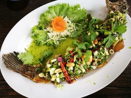 Serpent head fish fry herbs, Thai Food Stock Photo