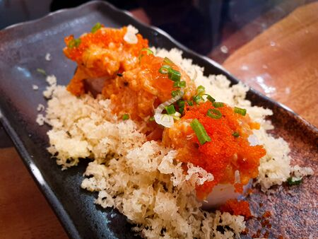 japanese food sushi roll and topping egg shrimp with Fried Tempura Flour on dish 스톡 콘텐츠