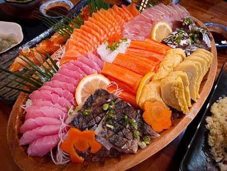 fresh sashimi set on wood dish 스톡 콘텐츠
