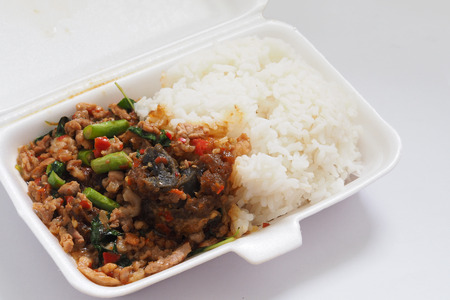 Pad Krapao Moo Sap or Fried Century Eggs with Minced Pork and Crispy Holy Basil Leaf On Rice In Foam Box For Take Home Reklamní fotografie