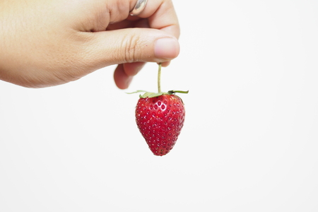 Pick up The Strawberry on white background.