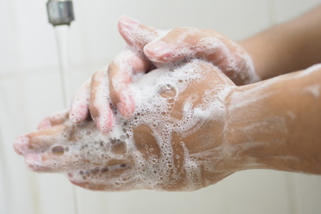 Close Up Of Medical Staff Washing Hands. Hand hygiene. Banque d'images - 122796349