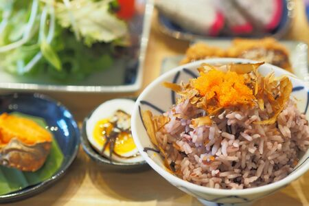 Riceberry and brown rice mix topping with Shrimp eggs and katsuobushi or bonito flakes - Breakfast set Japanese style