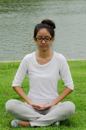 exhalation: Thai cute girl do meditation to study truth of life along buddhist way