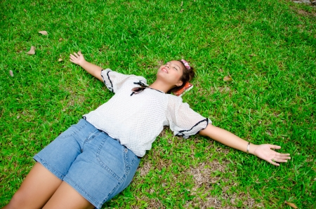 Thai girl sleep on the ground,emancipate,free,liberate Stock Photo - 14332912
