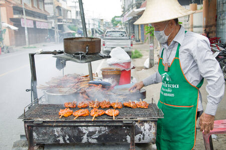 An Old Man Sell Local Roasted Chicken