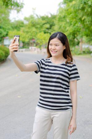 a Thai cute woman has a selfie with confidence