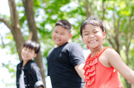 Children play at park and smile cheerfully and happily Stock Photo