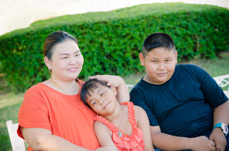 Mom and her children have wonderful time together at park Stock Photo