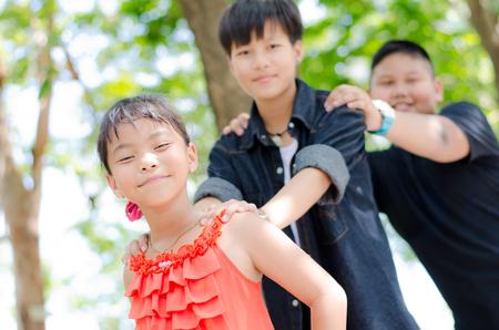 Three Children are having fun at local park