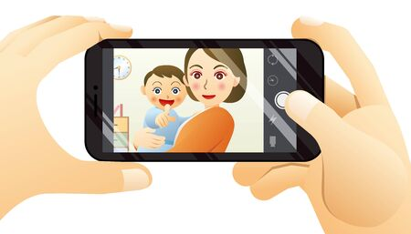 Mom and baby laughing at their dad taking pictures with a smartphone.