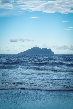 Guishan Island Landscape from Waiao Beach in Toucheng Township, Yilan, Taiwan. Stock Photo