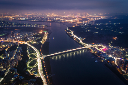 TamsiBali Night View Aerial Photography - Tamsui River with Gand Bridge birds eye view use the drone photography at ni ght, shot in Tamsui District, New Taipei, Taiwan.